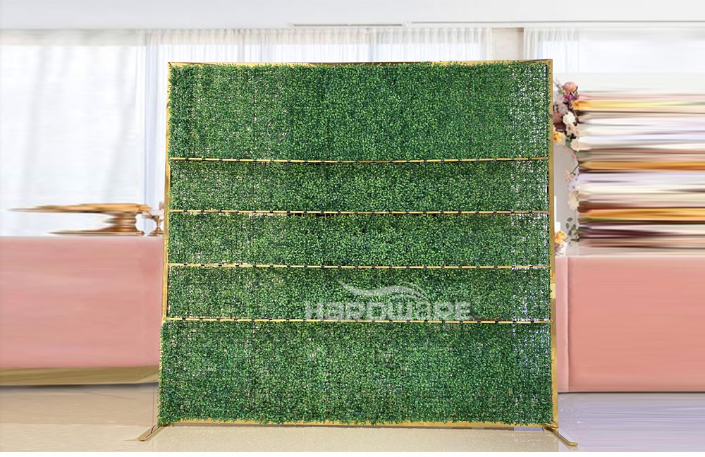 Party rental metal champagne wall with green grass